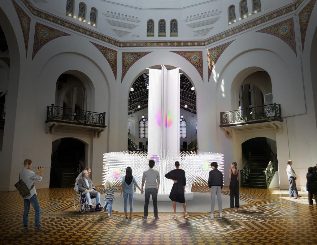 light sculpture in rotunda with people standing around