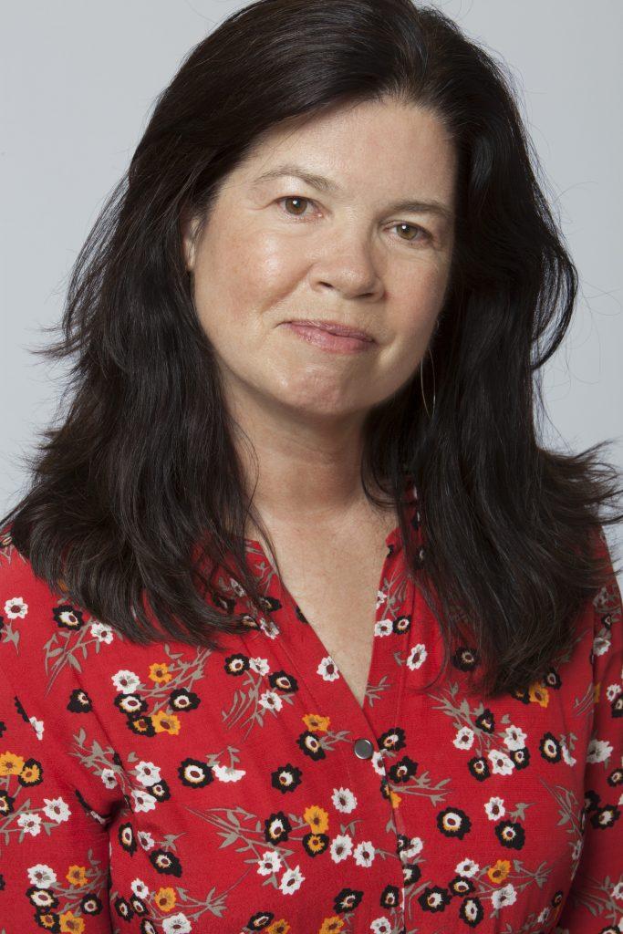 Portrait of a figure in a flower print shirt.